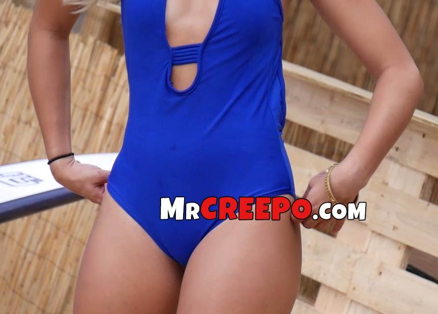 Up close voyeur look on hot blonde in blue swimsuit