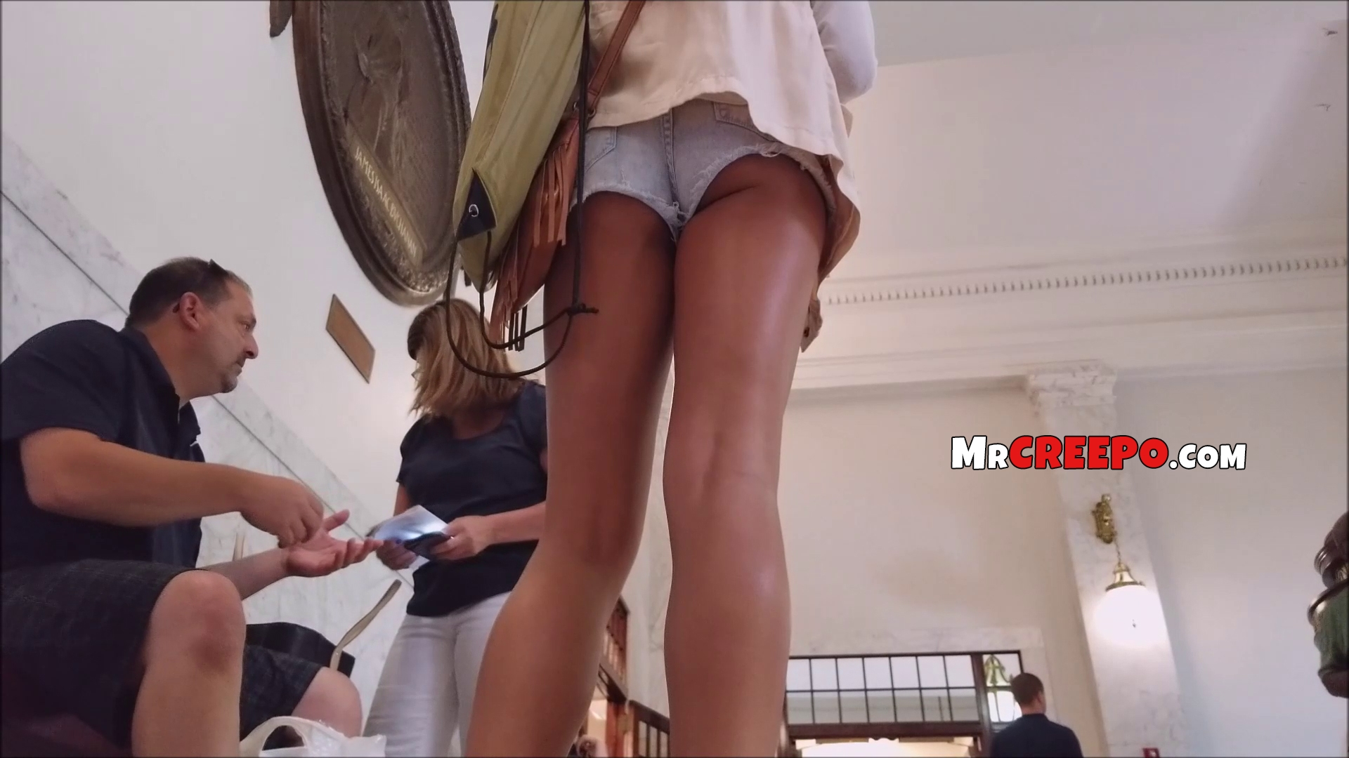Beautiful ass and tanned long legs caught by voyeur